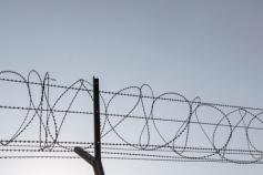 57939271 - silhouette image of barbwire fence in sunny day